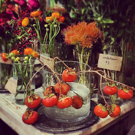Earthly delightful persimmons and flowers from Fleur.