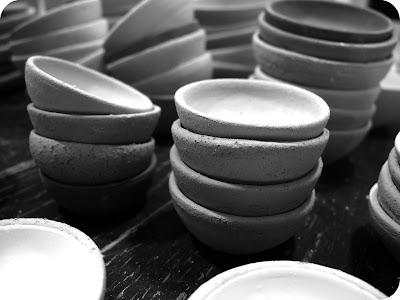 mini pottery bowls in piles