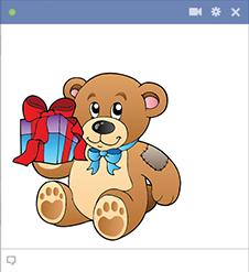 Teddy Bear Holding a Gift
