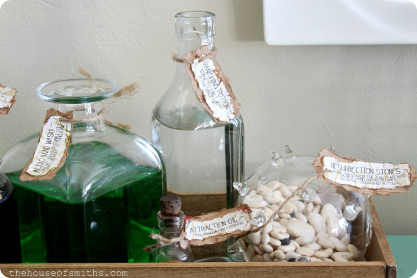 DIY halloween potion bottles with labels - halloween decor - thehouseofsmiths.com #halloweendecorations