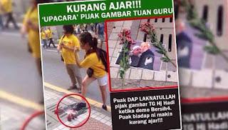 Aksi pijak gambar Najib, Hadi jadi viral
