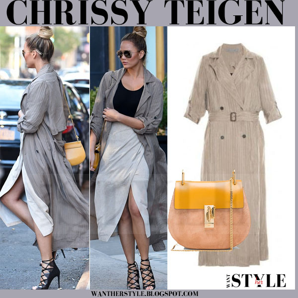 Chrissy Teigen in silk raquel allegra trench coat with black sandals and orange chloe drew bag what she wore models off duty