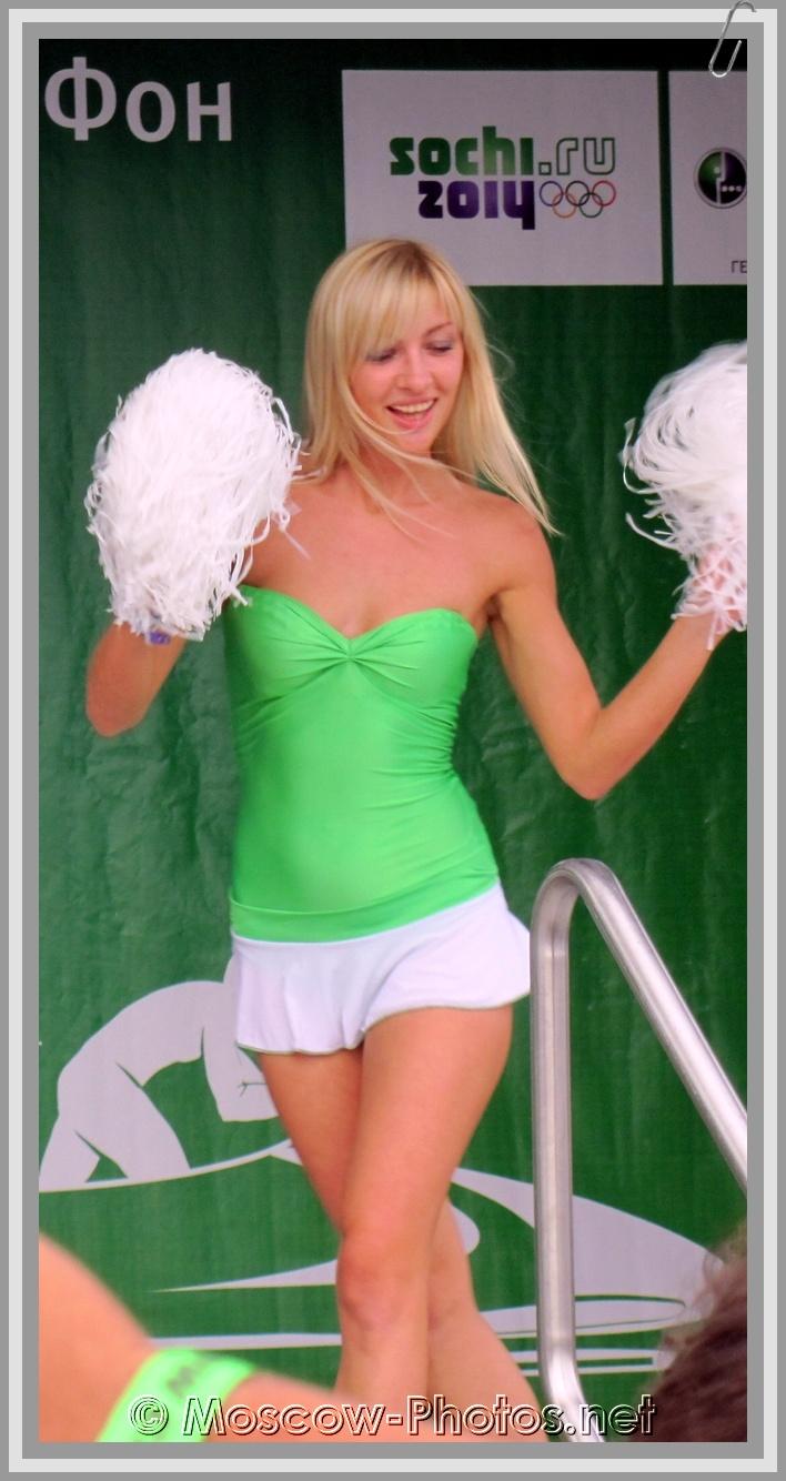 Dancing blonde girl in green top