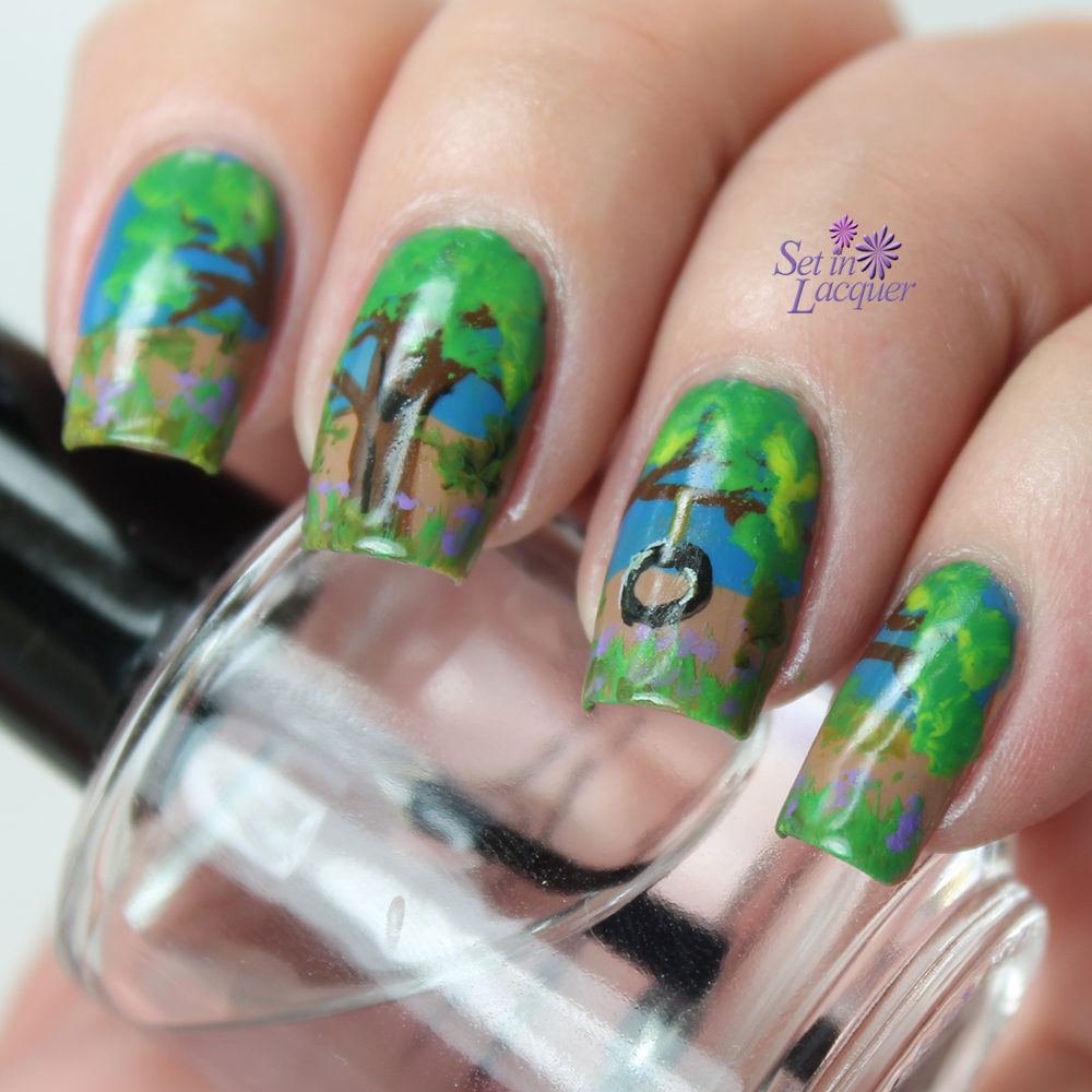 Tire swing in a tree nail art