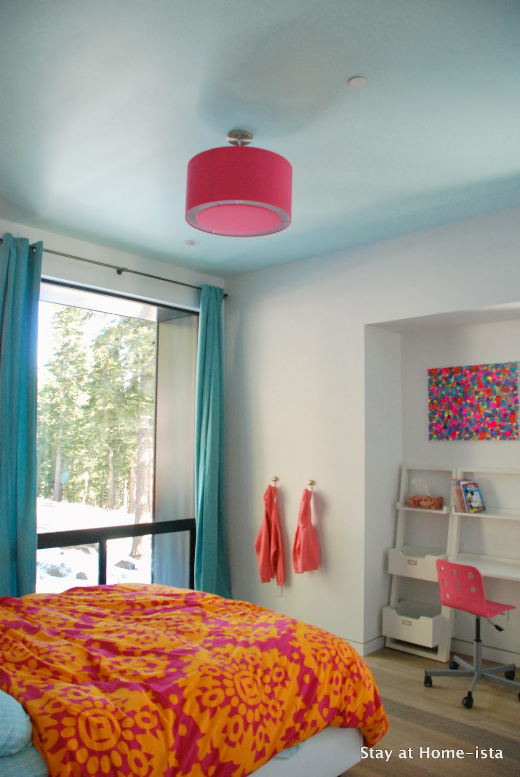 Bright pink, orange and teal in a modern house makes the perfect room for a growing girl.