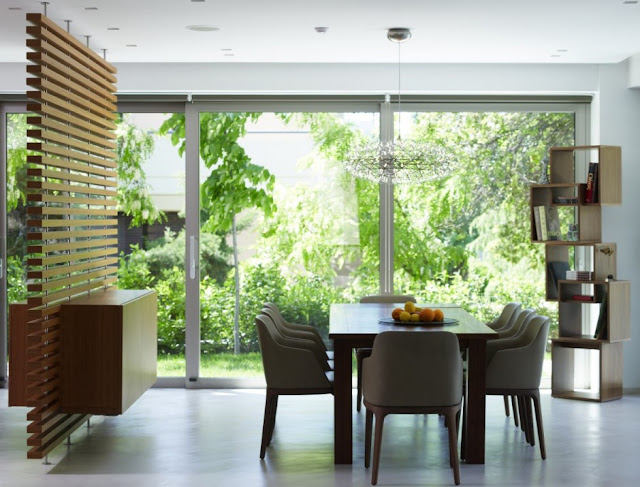 Dining room with vegetation outside