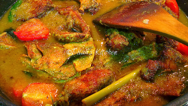 fried fish cooked in tasty turmeric gravy