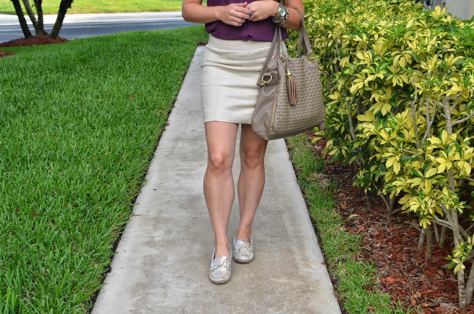 Purple top - tan skirt - silver boat shoes - stud bag