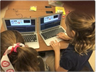 Third graders using mac Books