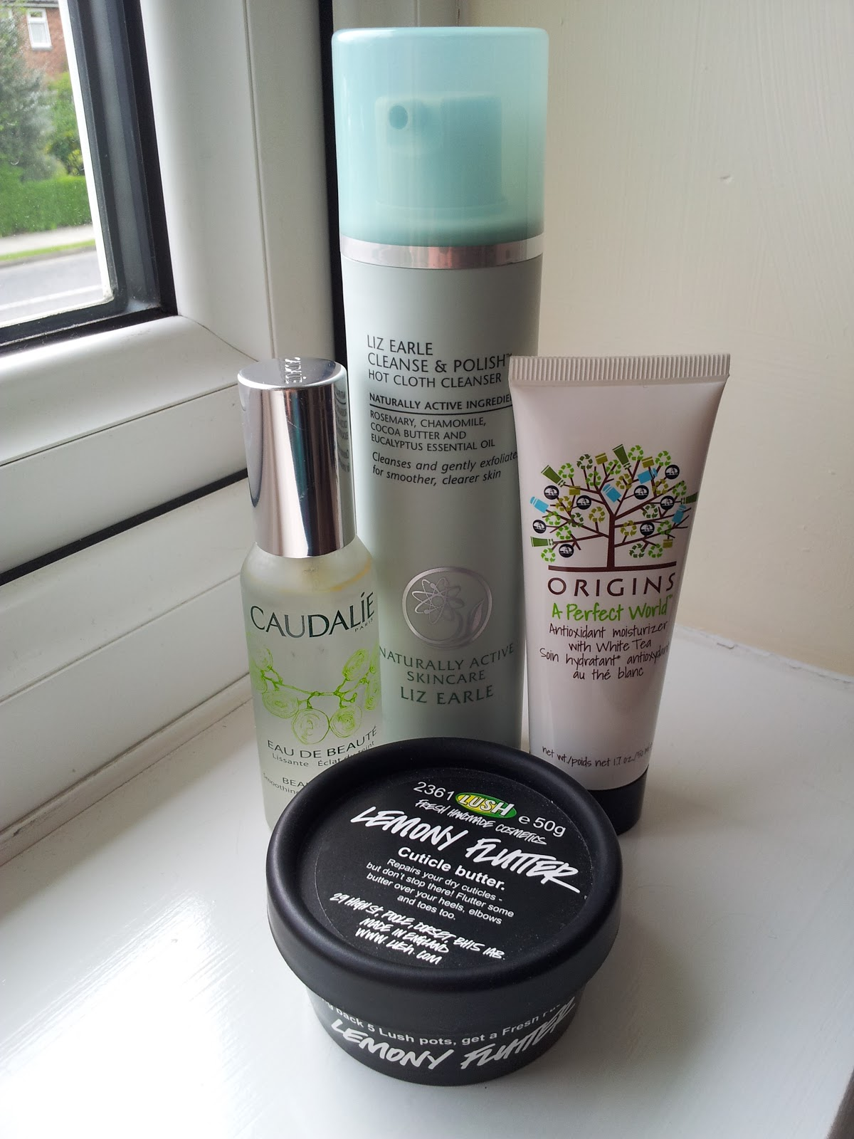Liz Earle Cleanse and Polish Hot Cloth Cleanser, Caudalie Beauty Elixir, Origins A Perfect World Moisturizer, Lush Lemony Flutter Cuticle Butter