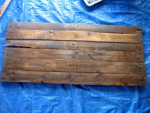 Making a DIY pallet sign out of refurbished wood.