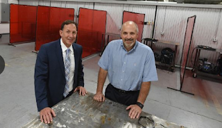 Lance-Bolton-president-of-Pikes-Peak-Community-College-left-and-Tom-Neppl-president-and-chief-executive-of-Springs-Fabrication-right-coordinated-in-opening-a-new-welding-training-center-to-address-skills-gap