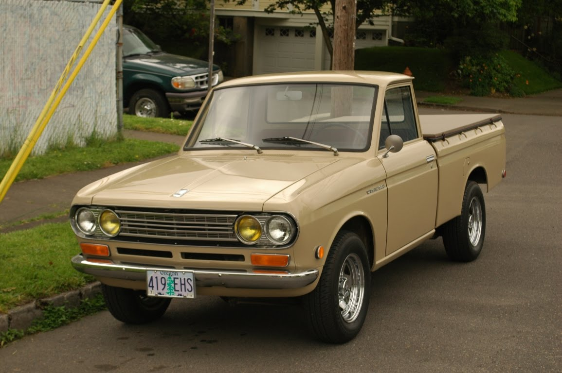 OLD PARKED CARS.: 1970 Datsun 1300.