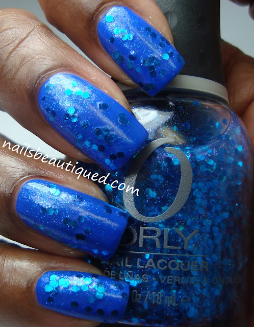 Orly Spazmatic layered over Sinful Colors Endless Blue