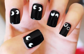 Halloween spooky eyes nail art for girls