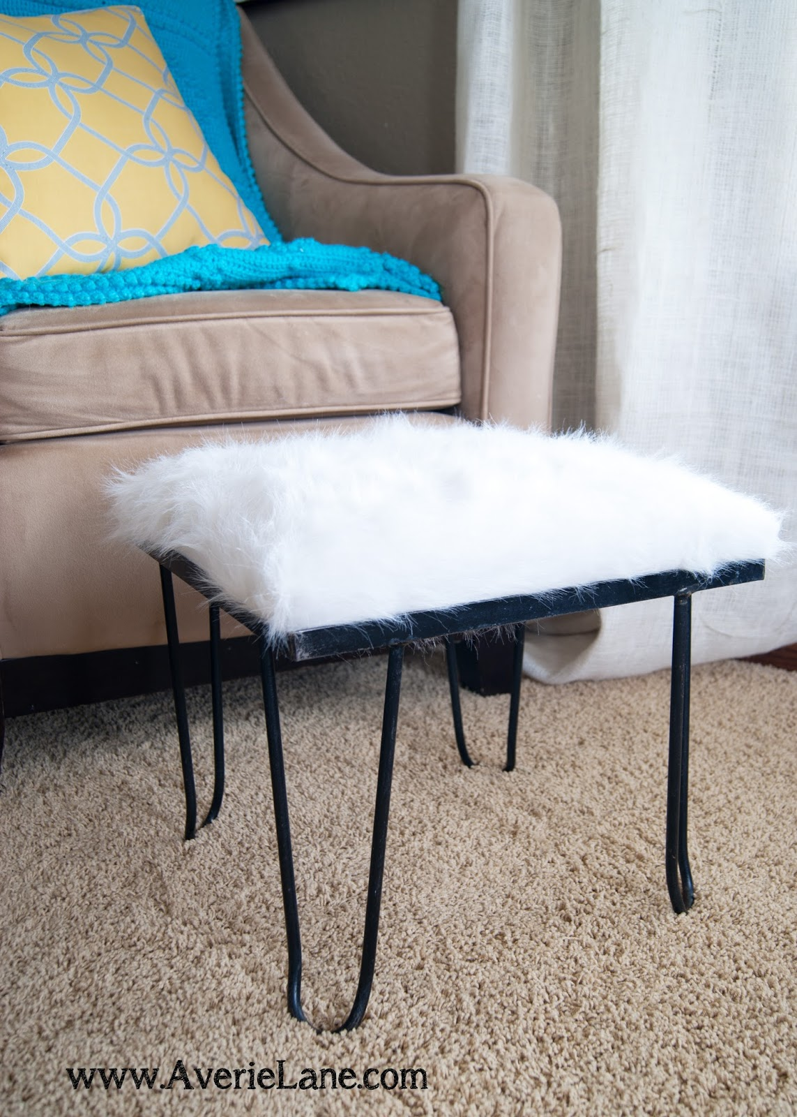 Hairpin leg stool with whit faux fur