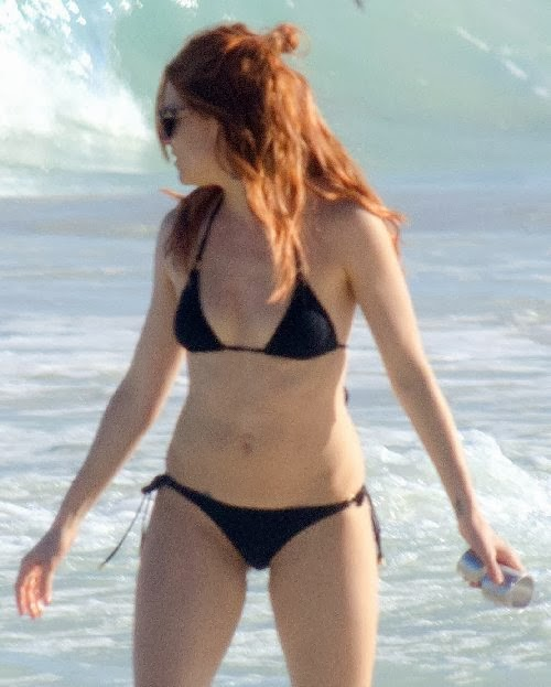 English:Sienna Miller Black Bikini Mexico January 21, 2014