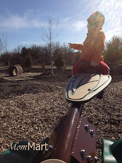 My child playing at the park.
