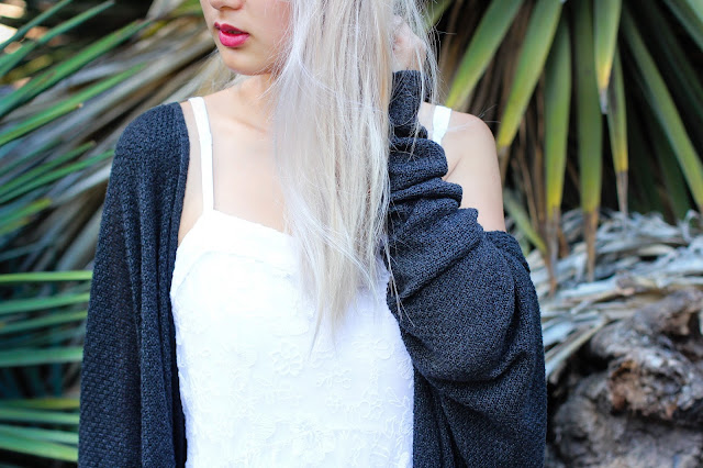 Details of a white Abercrombie dress and dark grey Brandy Melville Caroline cardigan.