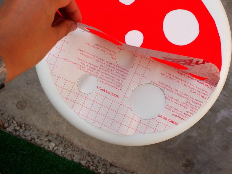 How to make a DIY toadstool stool:  Now attach the other half of the red contact paper