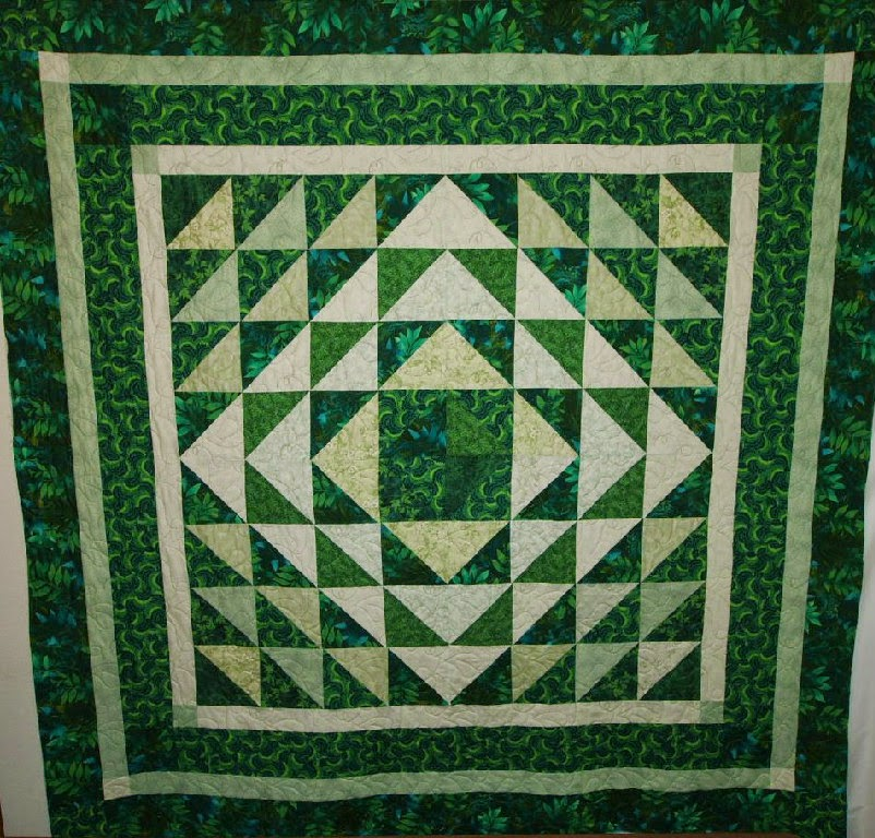 Claudia Swain's Half Square Triangles in Green's Quilt