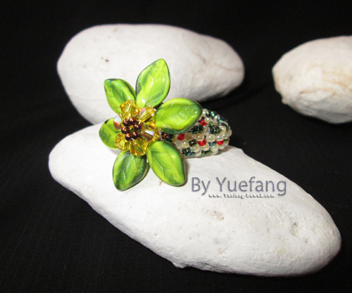 beaded_flower_ring_with_Czech_leave_beads_display_on_white_stone