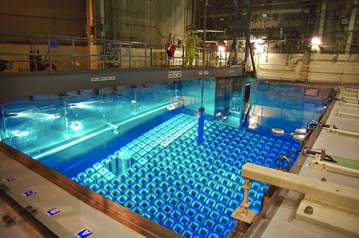 Stored nuclear fuel rods glow an eery, distinctive blue