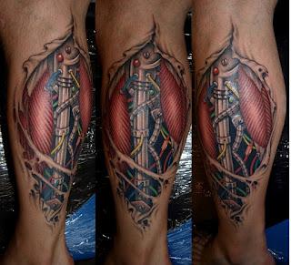 cyborg tattoo on the calf