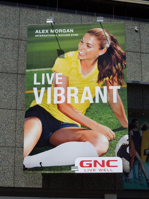 Alex Morgan Live Vibrant GNC billboard