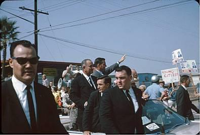 SA Darwin Horn (left), SA Lem Johns, and other agents with LBJ 1964