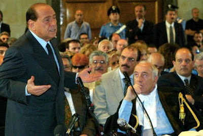 Silvio Berlusconi attending to one of his trials