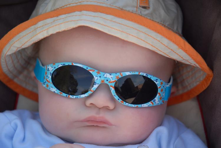 child wearing sunglasses