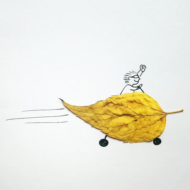 Coche amarillo hecho con una hoja de árbol