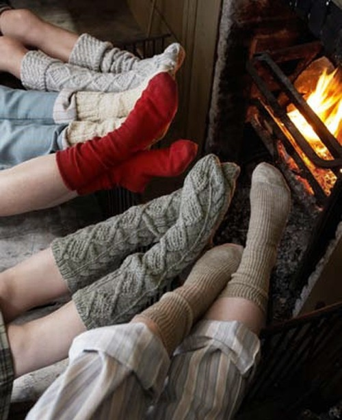 cozy cable socks by the fireplace