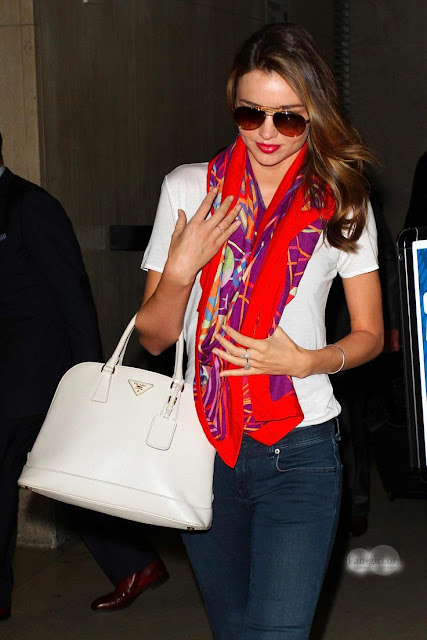 Red scarf, white shirt, blue jeans and white hand bag for ladies