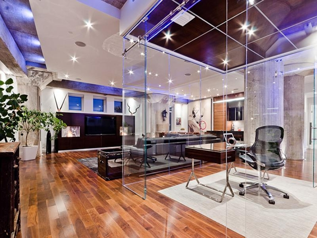 Picture of glass cube and living room with built in tv