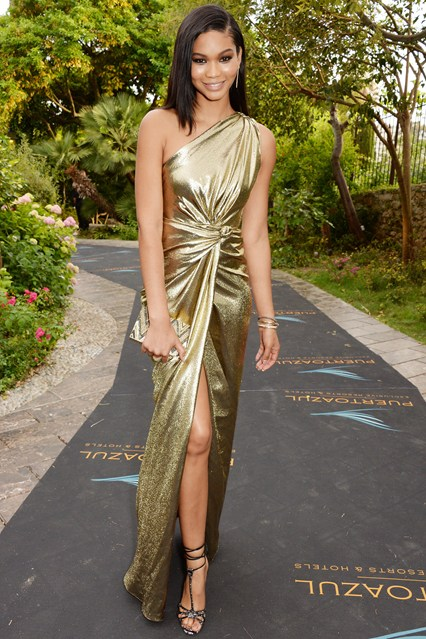 Chanel Iman accessorised her gold Reem Acra gown with Jimmy Choo heels at Cannes 2014