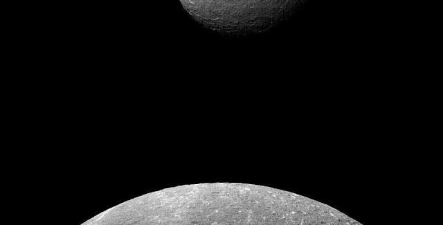Cassini captured this image when Dione was much closer to the camera, making the moon appear much bigger than her larger sister moon Rhea. Credit: NASA/JPL-Caltech/Space Science Institute
