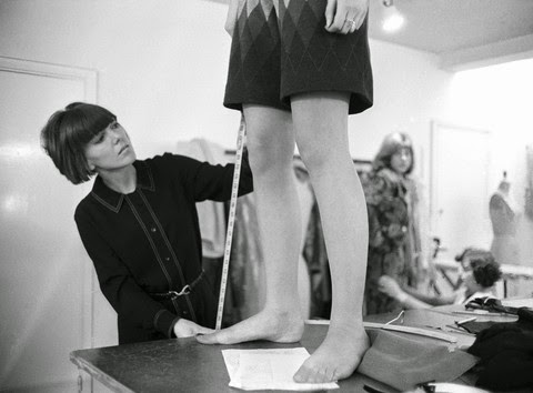 Mary Quant in her lab in Chelsea, London, measuring the length of a mini skirt, 1965