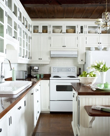 white+kitchen+glass+cabinets+white+appliances+wood+counters jpg