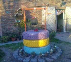 Curiosas ideas pozo para el jard n hecho con neum ticos for Decoracion de jardin con neumaticos