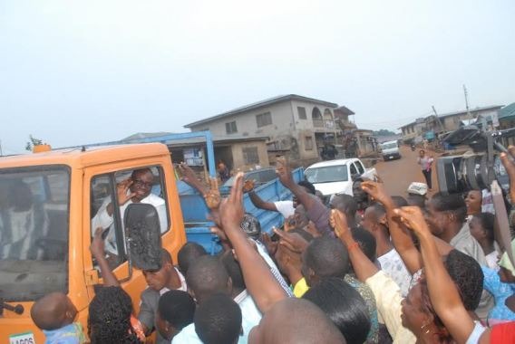 PHOTO OF THE DAY: Residents cheer as Governor Fayose drives a Tipper Lorry in Ekiti