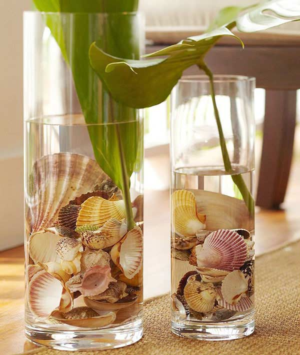 These stunning centerpieces use seashells as vase fillers