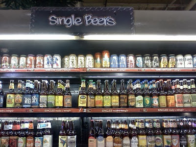 photo: cans & bottles of beer on the shelf