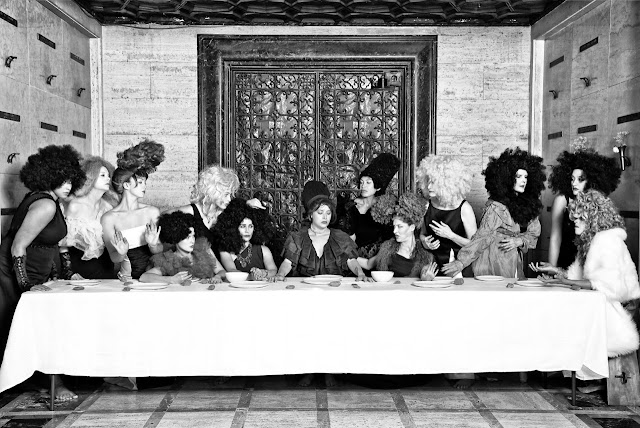 """Her Last Supper"" from the series ""Her"" by Marjorie Salvaterra (2014) Is a photographic reinterpretation of the ""Last Supper"" with woman in similar poses are the men in that painting. Their, makeup, and costumes are very flamboyant and the image was set inside a mausoleum, with a large door pull providing a halo around the head of the central figure."