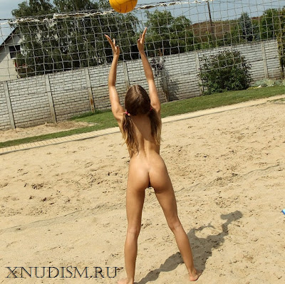 Naked girls nudists youngsters are having sex on a beach volleyball field