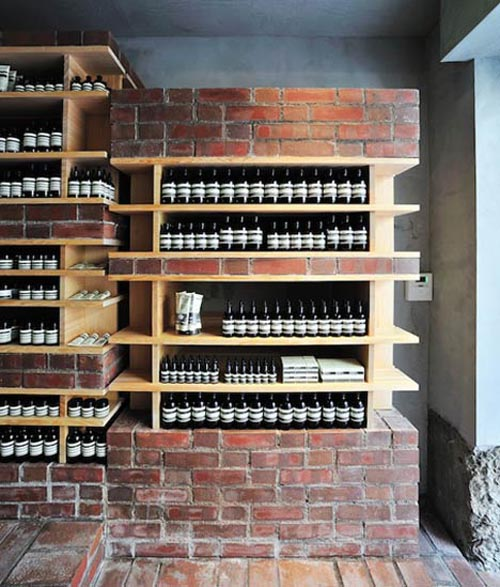 Traditional Chemical Store Design with Unfinished Brick Interior