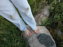 Girl Walking Barefoot On Rocks
