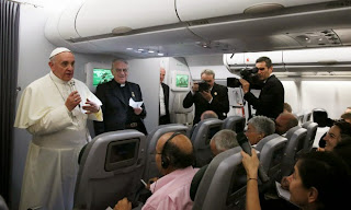 Pope Francis in an aeroplane