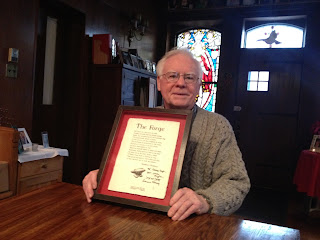 Father Michael with his signed Heaney poem